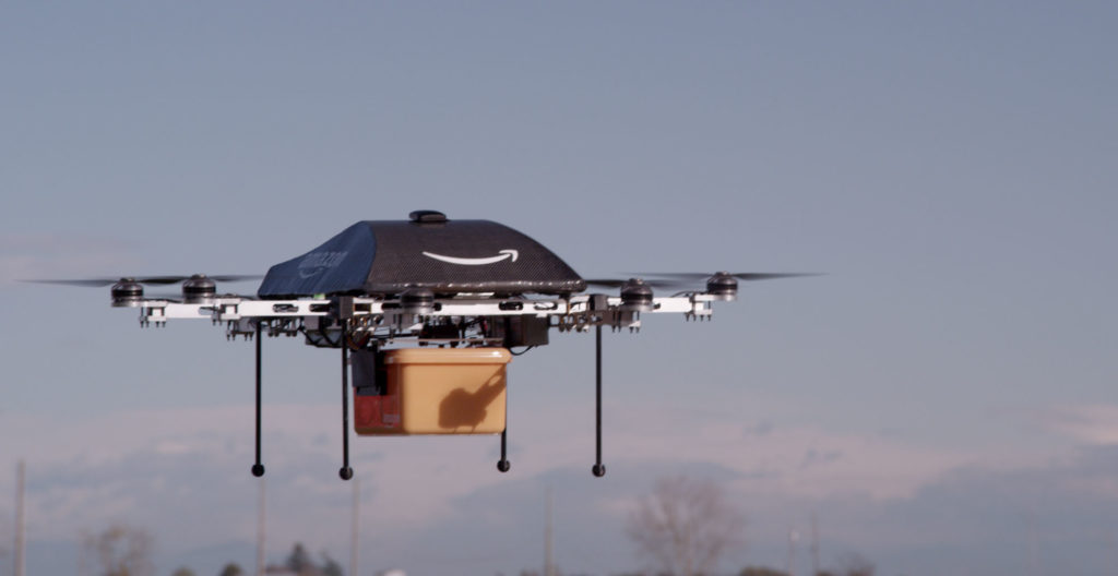 an Amazon drone carries a package