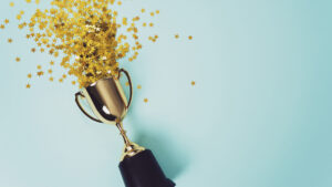 Confetti flowing out of a trophy to celebrate a winner to represent best video marketing examples