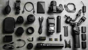 A selection of video production equipment laid out on a table