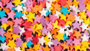 photo of multi-colored star-shaped sprinkles