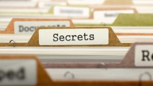 A file folder full of The Secrets to Virtual Selling for Financial Services